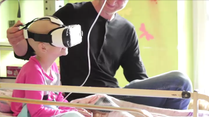 Little girl experiencing VR while undergoing chemo treatment. Photo credit to Futurism. LINK: https://futurism.com/a-tech-startup-is-using-virtual-reality-as-a-weapon-against-cancer/